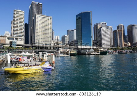 people with yellow passenger speed boat at harbour taken in Sydney Australia on 7 July 2016