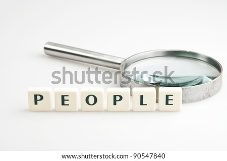 People word and magnifying glass - stock photo