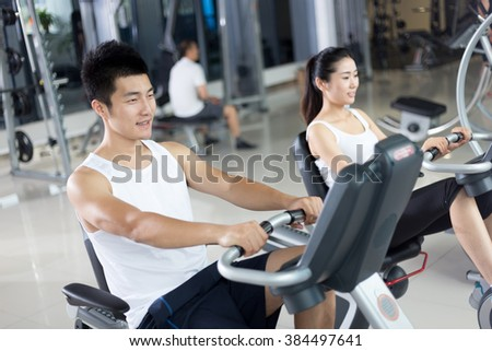 people work out in modern gym