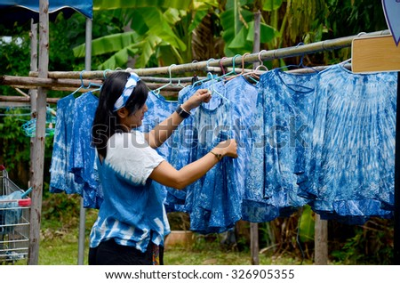 People working Batik dye Mauhom color process dry clothes in the sun