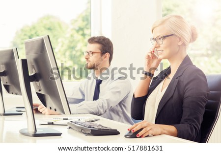People working in a modern office. Businessman and businesswoman at work. Business concept.