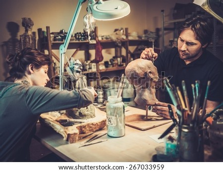 People working in a prosthetic special fx workshop - stock photo