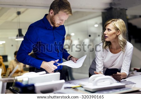 People working in fashion industry and designing clothes