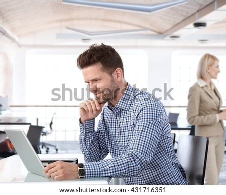 People working in office, businessman using laptop at desk. - stock photo