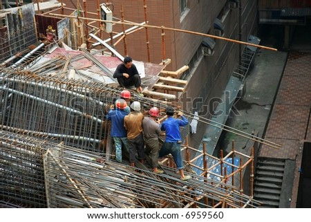 People working on the construction of a highway in Chongqing in China - stock photo