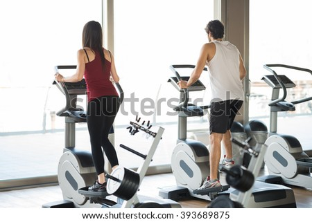 People working out in a fitness center - stock photo