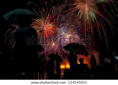 peoples in silhouette enjoy watching firework show celebrating new year