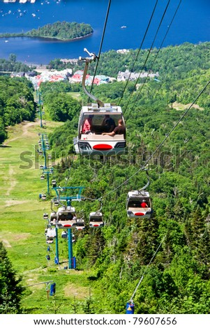Peoples using the chairlift to ascend and descend the Mountain Tremblant Quebec, Canada - stock photo