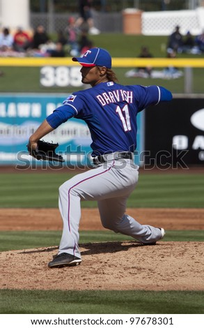 PEORIA, ARIZONA, USA -MARCH 7: Yu Darvish of the Texas Rangers throws his first pitch of Spring Training in Peoria, Arizona on March 7, 2012.