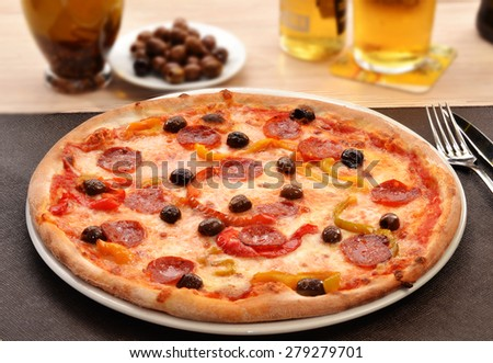 Peperoni cheese pizza dish and ingredients. - stock photo