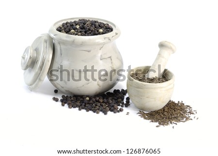 Pepper and Cumin in little bowls on on white background - stock photo