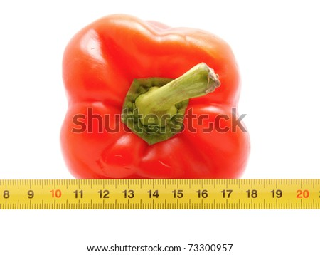 Pepper and ruler on a white background