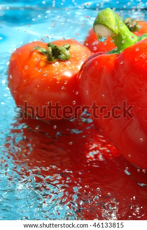pepper and tomato in water - stock photo