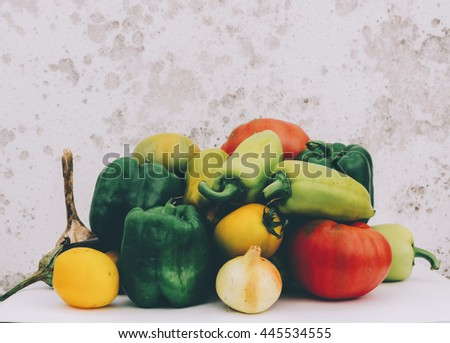 Pepper, garlic, onion and pepper on the table - stock photo
