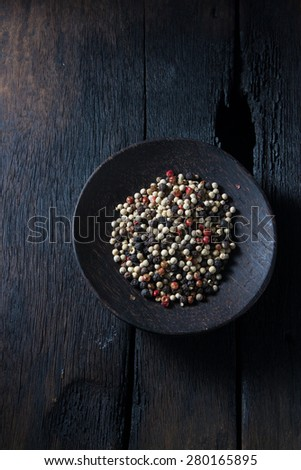 pepper in wooden background/ mixture of red pepper, black pepper, white pepper, green pepper - stock photo