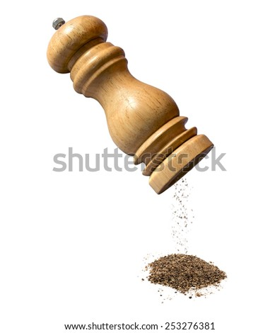 Pepper mill and black pepper on white - stock photo