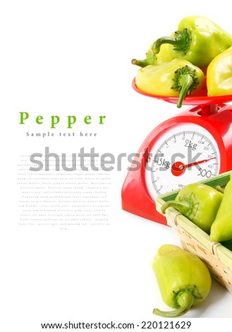 Pepper on scales and in a basket. On a white background.