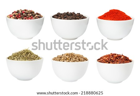 Pepper, rosemary, coriander and paprika spices in a bowls isolated on white - stock photo