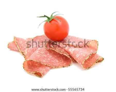 pepper salami sausage with tomato. - stock photo