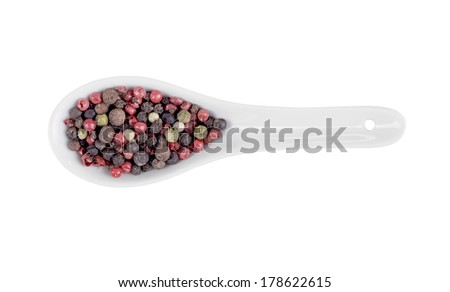 Pepper seasoning mix in spoon isolated on white background