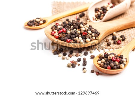 Peppercorn mix in wooden spoon