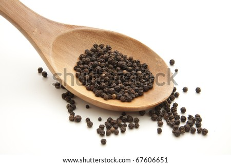 Peppercorns onto wooden spoons