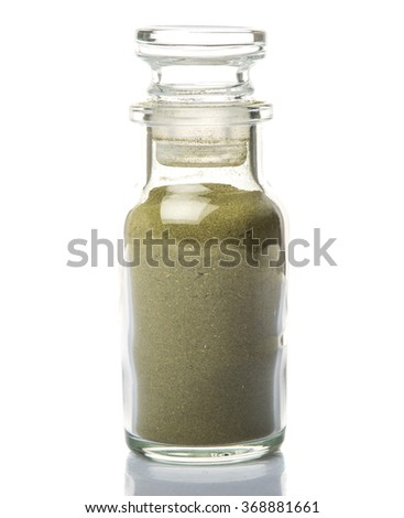 Peppermint herbs powder in spice glass dispenser over white background