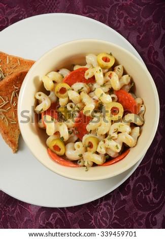 pepperoni pasta and garlic bread at restaurant - stock photo