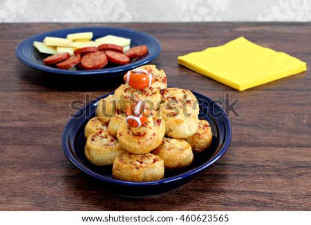 Pepperoni pinwheel snacks garnished for dad with footballs.