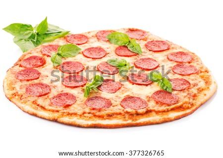 Pepperoni pizza beautiful arrangement Overhead studio shot of isolated Pepperoni pizza beautiful arrangement  - stock photo
