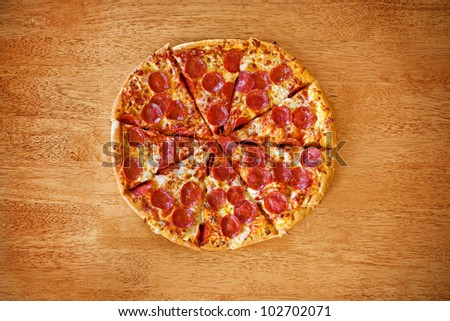 Pepperoni pizza on wood table. - stock photo