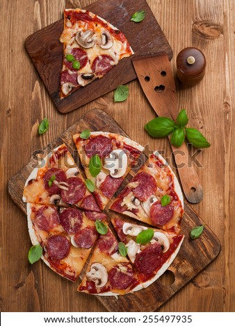 Pepperoni pizza with mushroom, selective focus - stock photo