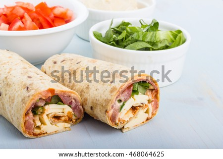Pepperoni, tomato, lettuce, harissa and hoummous gently wrapped in tortilla.