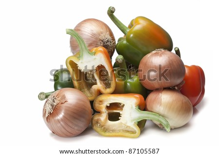Peppers and onions isolated over a white background.