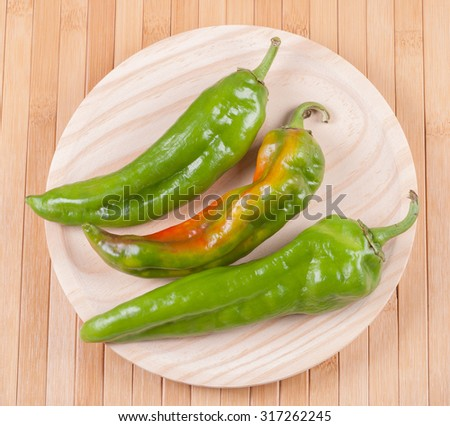 Peppers on a wooden table