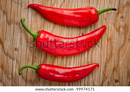 Peppers on wood - stock photo