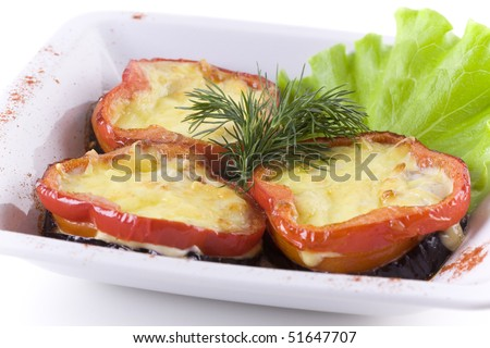 Peppers stuffed with cheese in white bowl. close up - stock photo