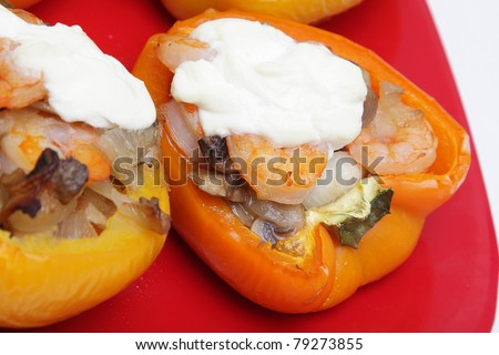 Peppers stuffed with shrimps, mushrooms and onion - stock photo