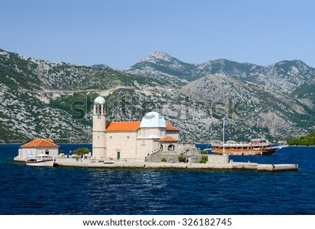 PERAST, MONTENEGRO - SEPTEMBER 16, 2015: Unidentified tourists visit the Island of Our Lady on the Reef near the town Perast in the Bay of Kotor, Montenegro
