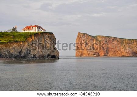 Percé Rock at sunset (Quebec) - stock photo