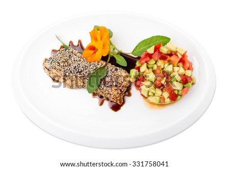 Perch fillet with tomato and avocado salsa covered with sesame seeds. Isolated on a white background. - stock photo