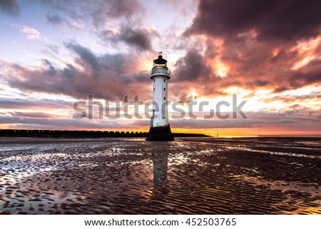 Perch Rock Lighthouse, in the center of the frame. New Brighton, Merseyside at sunset