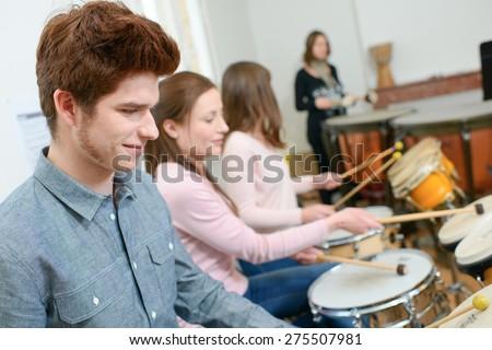 Percussion lesson - stock photo
