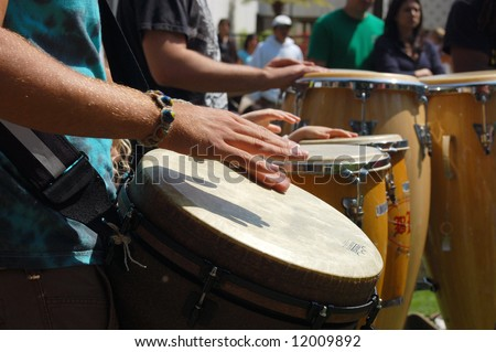 "Percussionists playing drums; ""Earth Day"" celebration; Balboa Park; San Diego, California - stock photo"