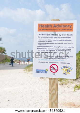 PERDIDO KEY - JUNE 9: A health hazard sign is shown posted on a popular vacation resort beach on June 9, 2010 in Perdido Key, Florida.  Oil threatens wildlife and tourism in the area. - stock photo