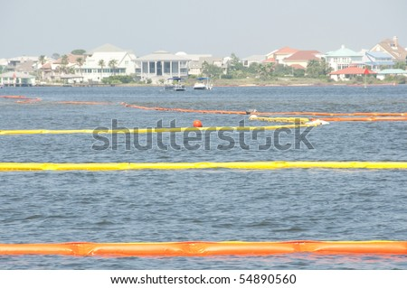 PERDIDO PASS - JUNE 8: Protective oil boom is draped throughout Perdido Pass, AL on June 8, 2010 in an attempt to protect the resort town and wildlife from the approaching BP oil slick. - stock photo