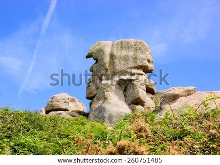 Pere Trebeurden (Father Trebeurden)  - granite rock in shape of male head at Pink Granite Coast near Trebeurden (Brittany, France).  - stock photo