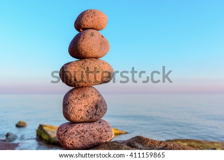 Perfect balance of pebbles on the seashore - stock photo