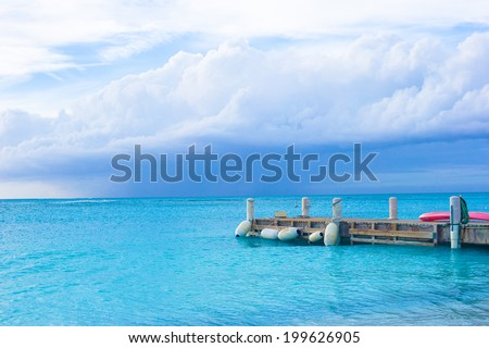 Perfect beach pier at caribbean island in Turks and Caicos - stock photo