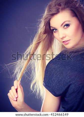 Perfect beauty. Young attractive glamorous female model studio shot. Gorgeous charming blonde woman with make up and waving hair looking seductive. - stock photo